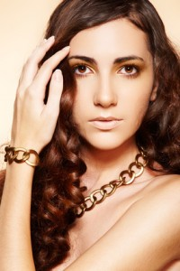 Model wearing a gold necklace